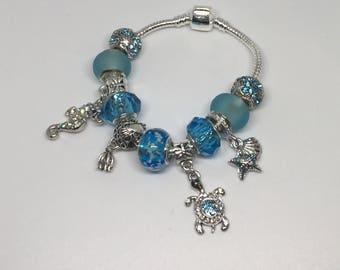 Sea life themed charm bracelet. Fits size 4-4.5 inch wrist.