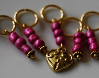 Locket and pink bead stitch markers