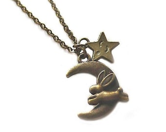Clearance sale Antique bronze bunny rabbit jumping over the moon and star charm necklace