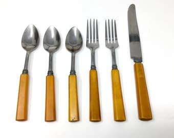 6 vintage butterscotch  Bakelite flatware pieces spoons forks knife