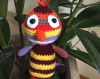 Amigurumi: A colorful chick made by hand with crochet