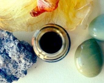 Infinite. natural perfume. botanical petrichor fragrance. wet stone, jungle undergrowth, humidity, baked earth, storm dust. attar mitti.