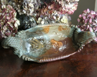 Hand built stoneware Viking serving boat. Rustic browns, tan, green and gold/bronze. Use it to serve from oven to table.