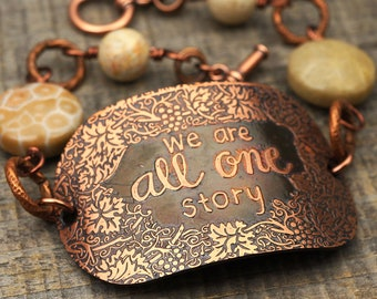 We Are All One Story bracelet, grey brown fossilized coral beads and etched copper, phrase jewelry, 8 1/4 inches long