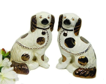 A Pair of Antique English Staffordshire Hearth Dogs White and Copper Luster