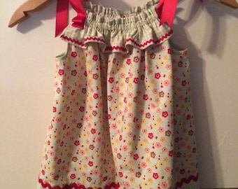 Pillowcase dress  with ribbon ties at the shoulders.