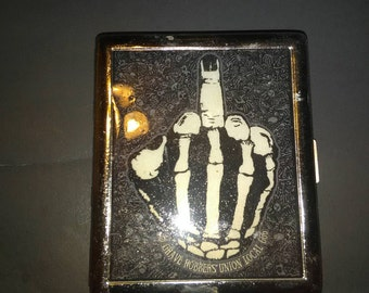 "Cigarette, card, cash, case ""skeleton hand giving the bird"" - Psychobilly, Goth, Punk"