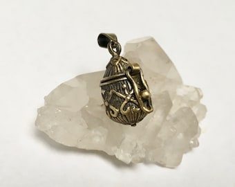 tiny gold plate poison pendant
