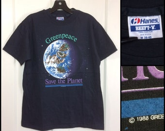 deadstock 1980s 1988 Greenpeace t-shirt size medium 19x26 black Hanes cotton Save the Planet environment Earth Day Green Peace nature space