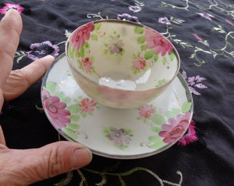 Vintage Japanese Unmarked Porcelain Teacup and Matching Saucer Set.  Trimmed with Gold = Daisy like pink and purple flowers  Beautiful
