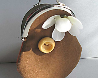 brown linen and orange change purse with a flower