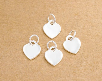 4 of 925 Sterling Silver Heart Charms 8x9 mm. :tk0175