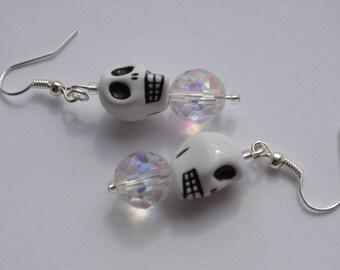 a pair of skull earrings