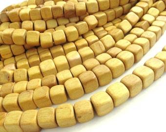 10 perles de bois carrées jaunes de 12mm