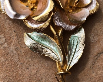 """Floral enameled brooch, signed """"Coro"""""""