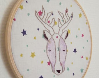 Embroidered deer on stars