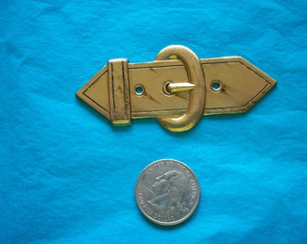 2 metal buckle-like pieces late 40s Japan store stock