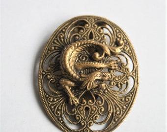 Vintage dress clips. Brass dress clip. Mythical creature decoration