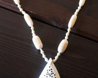 Faux vintage ivory eyelet necklace