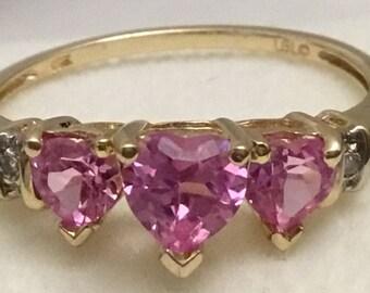 Vintage three heart pink sapphire ring.