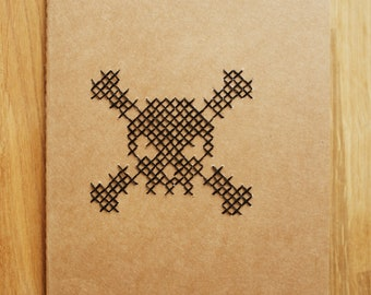 Lined notebook with skull
