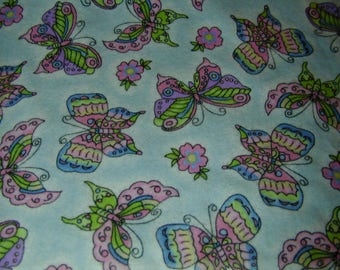 Flannel Fabric in Blue Background with Pink Butterflies and Flowers