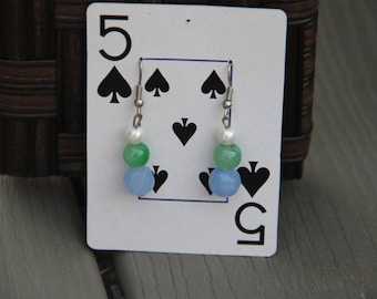 White, green and blue earrings