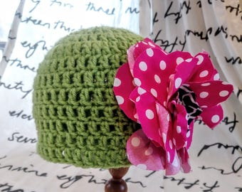 Bright, happy green crocheted winter hat with pink polka-dot shabby fabric flower