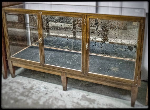Antique Edwardian shop counter with distressed mirror back and mahogany frame