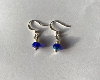 Earrings with blue faceted glass beads.