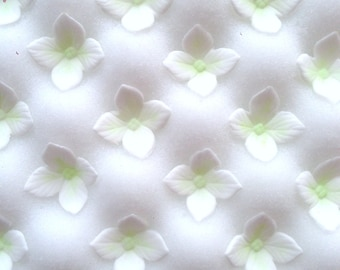25 x handmade sugar hydrangea flowers.  Made to order in any colour you like.