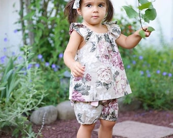 Complete set - floral flutter top and bloomers with contrasting tie. Available in sizes nb- 6 yrs