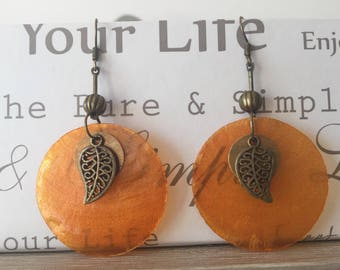 Orange pearl earrings and copper charms