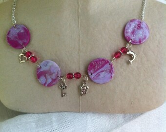 Silver necklace fuchsia and patterns