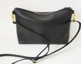 Gold hardware black leather crossbody bag with zipper