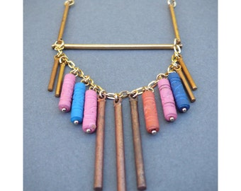 Long pastel carved clay and brass fringe necklace on goldfill chain