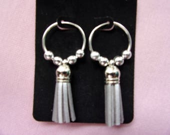 Silver beaded continuous hoops with tassel