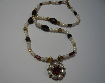 Garnet and Pearl necklace with gold beads and handmade gold flower center piece