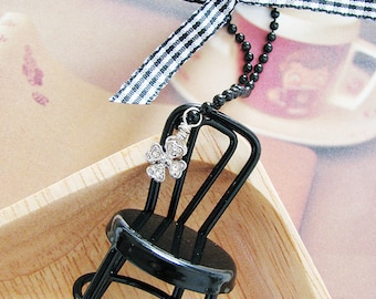 my lucky chair necklace. ebony metal chair with four leaf clover charm