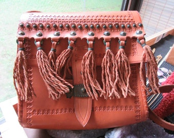 Vintage Southwest Design Hand Tooled Leather Riveted Bag with Decorated Fringe Buckle Strap