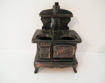 Acme Cast Iron Saleman Sample Vintage Child Toy Stove from  Early 1900s, plates and top ornament missing - very usuable S&P holders
