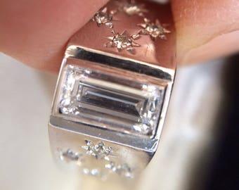 1960's 14k white gold band with brilliant emerald cut baguette diamond