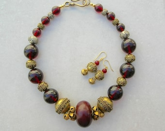 Bold Statement Necklace, Cherry Amber and Appliquéd Brass Beads, Brass Indian Bells, Matching Earrings, Necklace Set by SandraDesigns