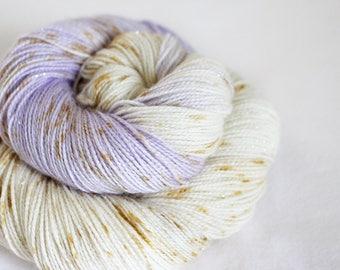 Navi - Magpie -  75/20/5 superwash merino/ nylon/ gold stellina sock yarn