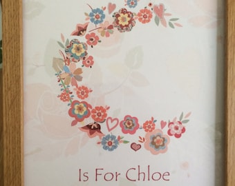 A Beautiful Personalised  Baby Initial filled with flowers and hearts print