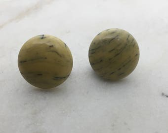 Imitation mustard marble stud earrings. 14mm with surgical steel and nickel free posts.