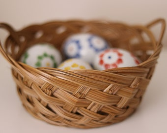 Small cane basket with handles