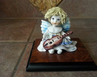 Sweet Porcelain Little Angel with Golden Spaghetti Hair, Playing the Guitar, Artist Signed, Beautifully Hand Painted, Excellent Condition