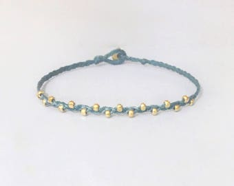 tiny faceted gold nuggets beaded friendship bracelet. riley.