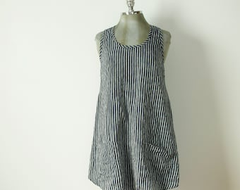 short medium a-line navy and off white striped linen dress or jumper with pockets racer back and shirt tail hem